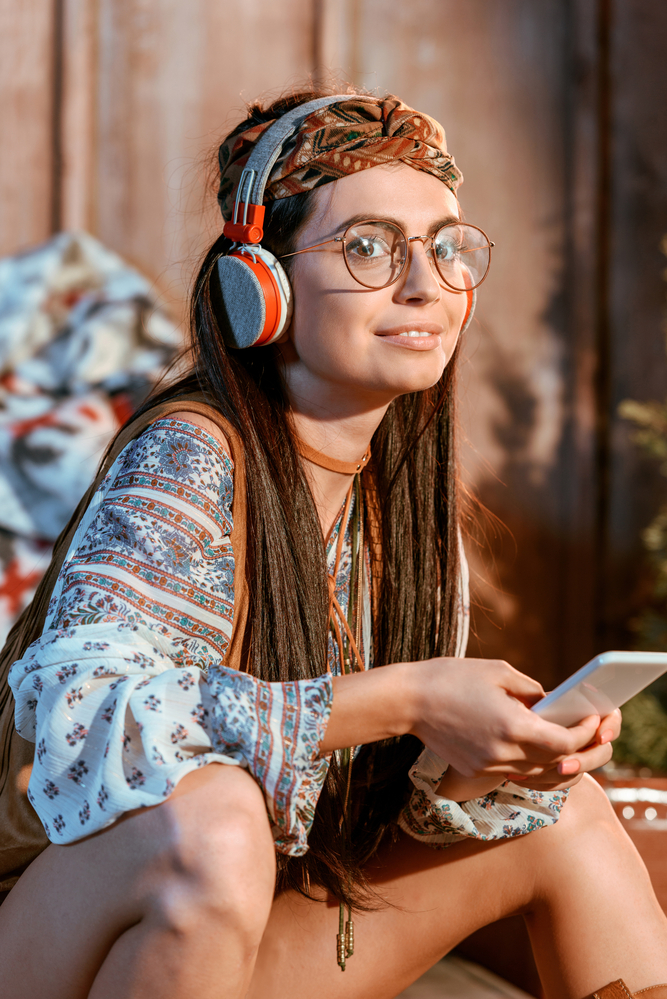 a woman who wears her headphones with her glasses on